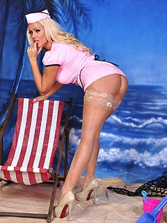 Waitress is spreading her sexy legs on a beach in this pin-up picture set: no panties there to cover up her bald cunt