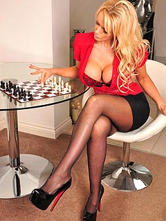 Busty blond is not that good in playing chess but the is just perfect in stripping and showing off great legs in nylons