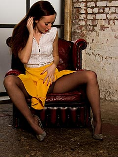 Classy yellow mini-skirt and black pantyhose is a perfect combination for slutty girl to do legs teasing