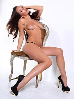 High heels and classy lingerie are the things that make women sexy and this brunette proves that fact