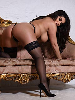 Curvy secretary is wearing very sexy lingerie and black nylons under her office dress