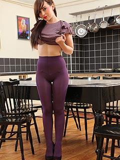 Slim babe is wearing purple pantyhose to match the color of her top and lingerie