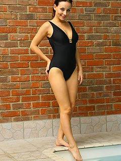 Black lycra swimsuit and a pair of leather boots is a nice setup for stripping scene you are invited to enjoy