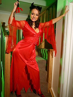 Hot babe is turning herself into a witch by putting on red robe and a red stockings
