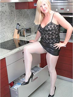 Housewife enjoy dressing like a slut: short leather mini-skirt and sheer white pantyhose is her choice of clothing for today