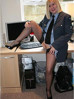 Uniforms are always very handy when women are posing for kinky pictures: this cop is a slut and loves to spread her legs
