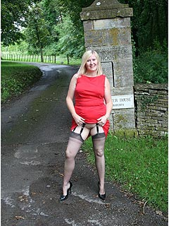 Mature slut is out on a dogging mission during the day: searching for men to fuck in red dress and black stockings