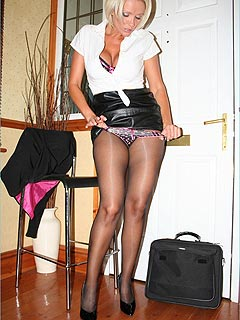 Office slut is pulling down leather skirt slowly exposing a perfect ass under a layer of black nylon
