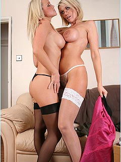 Two blonds are having good time with each other wearing nylon stockings of different colors