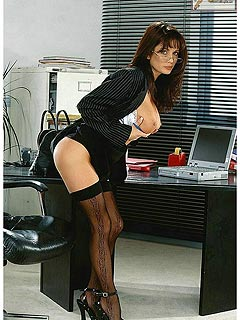 Busty office lady is going naughty at the end of the working day: taking kinky poses in gust black nylons
