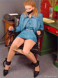 Redhead girl is tied to chair after the encounter with an intruder: tape-gagged and having her pantyhose lowered