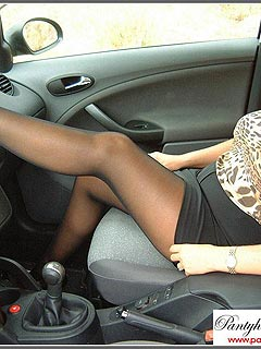 Mature babe on the passenger seat put her pantyhosed feet on the dashboard