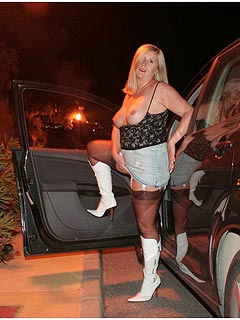 Mature blond is dressed up like a whore for a dogging mission: wearing short skirt and a pair of nylon stockings
