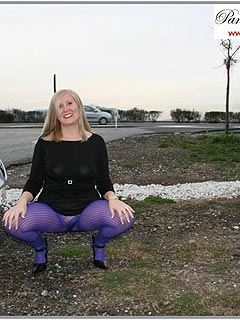 Housewife went outdoors to show people bright purple pantyhose she is wearing