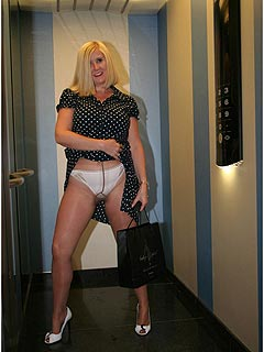 Perverted mum is flashing with her panties while taking an elevator