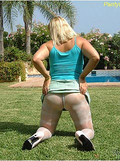 Plump amateur wife is out on the lawn making a slut out of herself flashing with up-skirts in white nylons