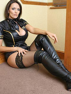Dominant Goddess is wearing black leather and knee boots: ready to tease some men