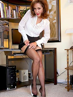 Lady-boss is taking down her clothes to check out the tops of the black stockings she is wearing