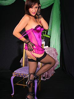Pink corset and black nylon stockings are the setup for sexy MILF Roni to enjoy pin-up style of clothing