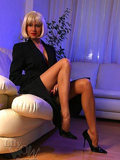 Lady-boss is using job interview as a chance to show off her legs in tan nylons and high heel shoes