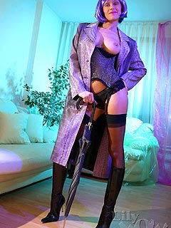 Slutty lady is making her striptease kinkier by hiding some sexy lingerie and nylons under the coat