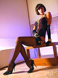 Babe is going to please you with sexy mix of long legs, black nylons and high heel shoes