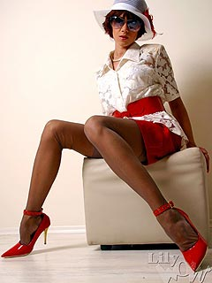 Naughty babe put on a pair of hot red high heels and nylon stockings to stroll on a sunny summer day