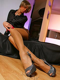 Lay down on the floor to enjoy high heel shoes and long legs in sheer vintage stockings