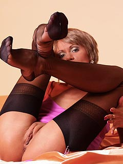 Bare pussy and a pair of legs in stockings are to be worshiped and enjoyed here