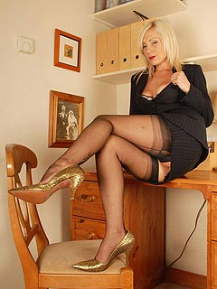 One of those exciting moments when bored secretary starts stripping down exposing her boobs and hot legs