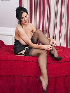 Classy lady is making men horny with a pair of hot legs in black seamed stockings