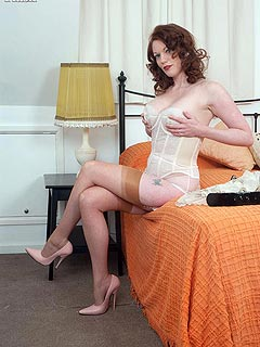 Date in the motel starts with naughty redhead housewife stripping down in a very kinky manner