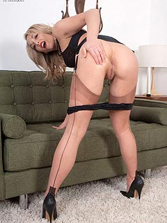 A set of classy black lingerie and seamed stockings is what next-door girl using to seduce men