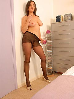 Attractive MILF loves the feeling of being slutty and exposes herself topless and in pantyhose for your viewing pleasure