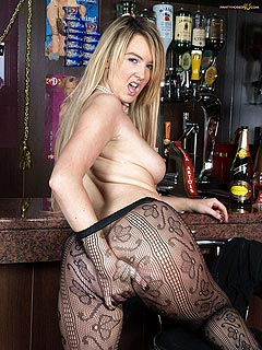 This girl is drunk enough to expose her sexy butt in the bar: black fishnets for you to enjoy