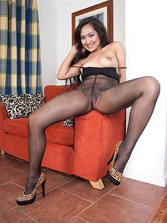 Exotic beauty loves the feeling of big balls sliding in and out of her pussy through the hole in her nylons