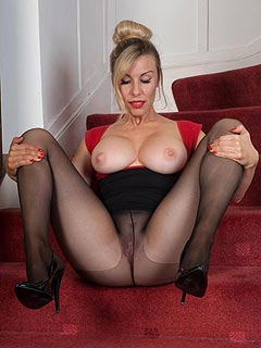 Horny MILF blond is pulling black pantyhose up to her boobs making a home down where her worn out cunt is