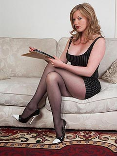 Naughty mom switches from reading to pantyhose posing and nylon ripping