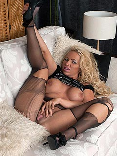 Blonde mom is ripping her pantyhose passionately dreaming about a big cock sliding into her pussy
