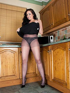 Next-door babe at the kitchen is doing what she does best: spreading legs and showing herself off in black nylons