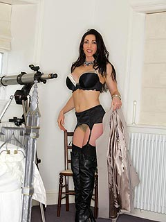 Spying makes Miss Hybrid horny: slutty lady is taking down her coat staying in black lingerie and knee-boots only