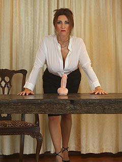Sexy teacher is using sex toy to show you the things she is planning to do with your penis