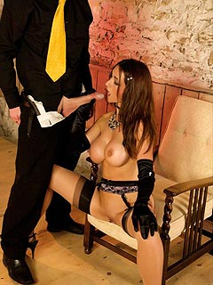 Mature cocksucker is pleasing her man by doing blowjob dressed up in suspender and stockings