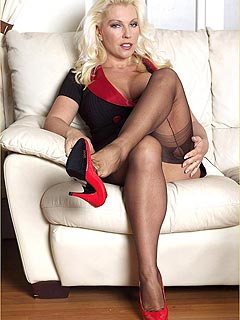 Sexy bimbo is taking high heels down to improve her footjob skills working out rubber cock with her feet in nylons