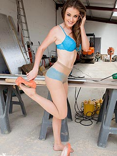 Redhead carpenter girl takes down denim shorts to continue her work in blue lingerie and pantyhose