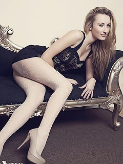Lovely gal looks very elegant in high heel shoes, white nylons and classy black dress