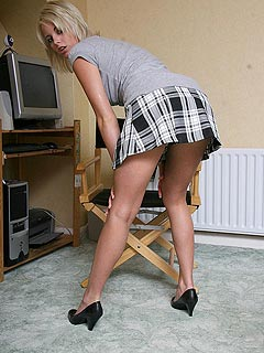 Secretary is making sexy bends as is they were totally accidental