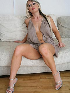 Enjoy the view of juicy MILF spreading her legs while sitting in a very kinky dress and high heel shoes