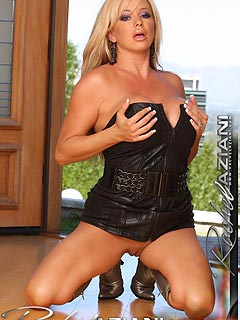 Blond cougar is unzipping leather dress going to show you a pair of big boobs and a perfectly shaved MILF pussy