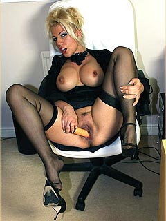 Office girl is getting used to doing business while there is a vibrating sex toy plugged in between her legs